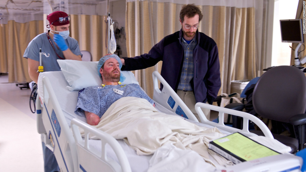 Will is joined by his twin, Tom, as he is wheeled into the operating room.