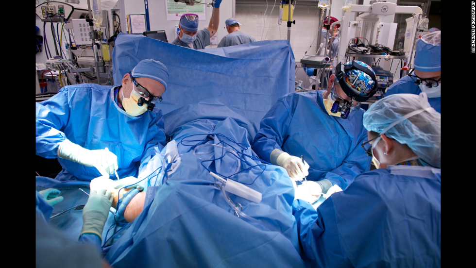 A team of surgeons perform Lautzenheiser's arm transplants. The arms came from an anonymous donor through the New England Organ Bank. <br />
