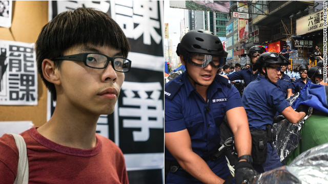 Joshua Wong, leader of student group Scholarism alongside an image of police action in Mong Kok, Wednesday, November 26.