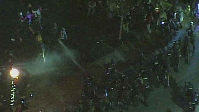 vos police spray water on protesters_00002022.jpg