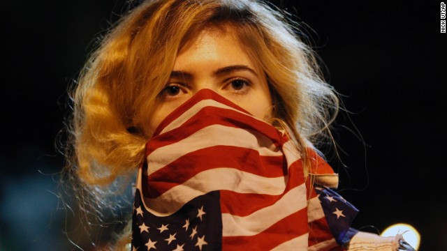A woman joins a rally near the Los Angeles Police Department headquarters on November 25.