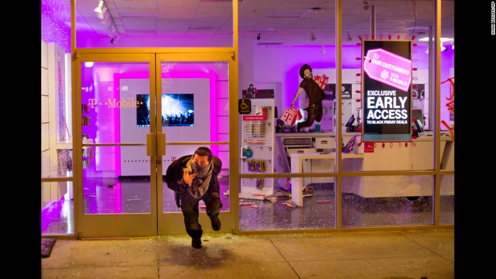 Businesses were looted in Oakland on November 25, including a T-Mobile store.