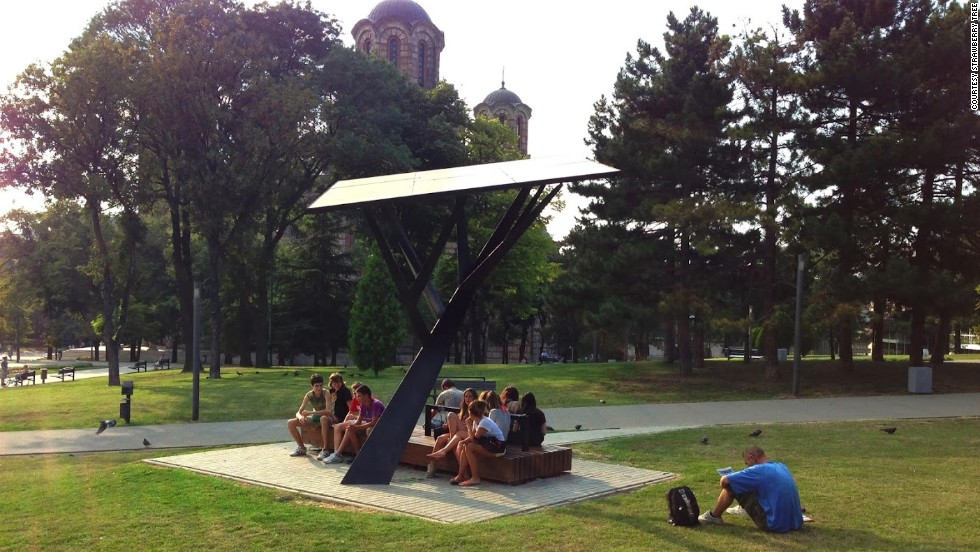 The Strawberry Tree is a public solar-powered station that allows users to recharge their mobile phones for free.