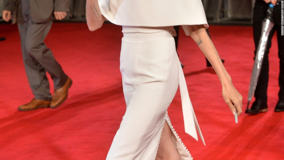 "Angelina Jolie waves as she arrives at the premiere of ""Unbroken"" in London on November 25."