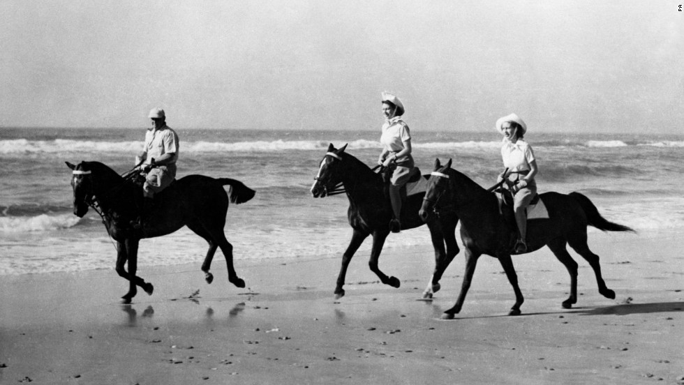 In 1947, while still a princess, Elizabeth (center) is seen riding on a South African beach.
