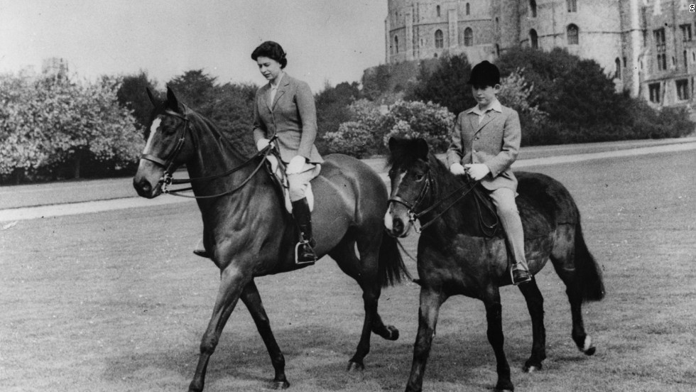 The Queen and her son, the Prince of Wales, riding at Windsor Castle.