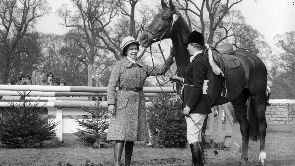 The Queen congratulates Princess Anne and her mount, Doublet, after they had taken fifth place in the 1971 Badminton Horse Trials.