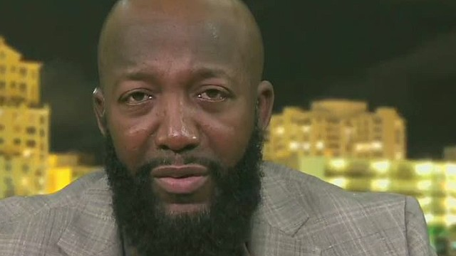 ac trayvon martin father on ferguson decision_00002617.jpg