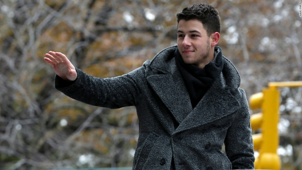 Singer Nick Jonas waves at the crowd.