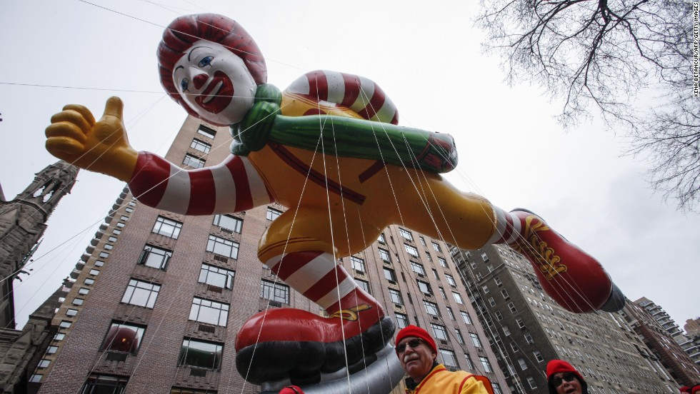 The Ronald McDonald balloon floats down Central Park West.