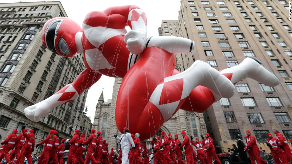 A Power Ranger balloon makes its way down Central Park West.
