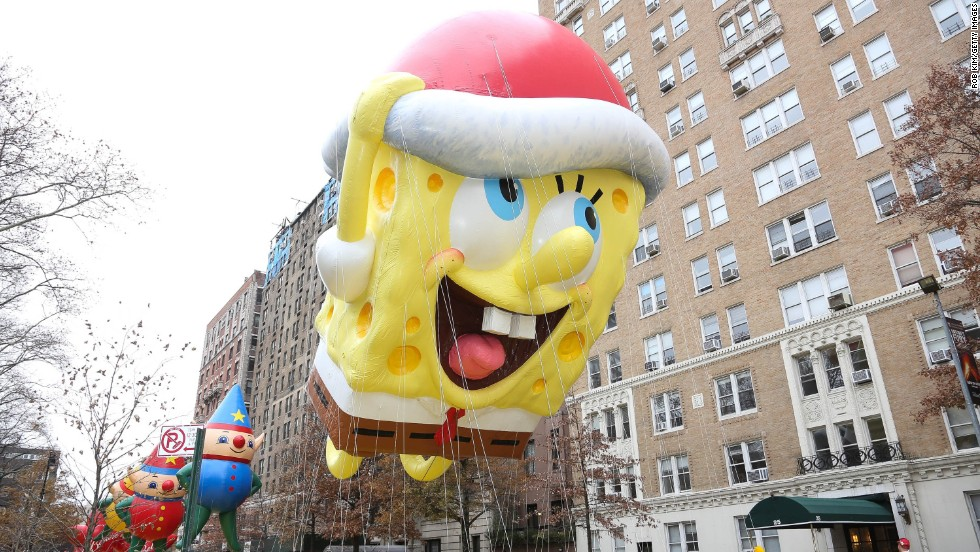 The SpongeBob SquarePants balloon floats down the street.