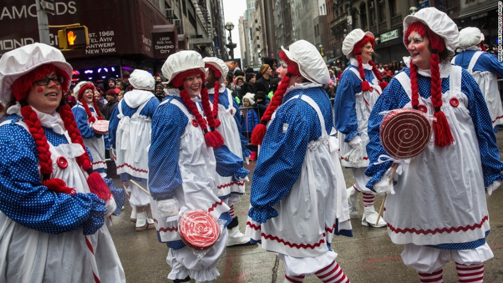 A group dressed as Raggedy Ann walks the parade route.