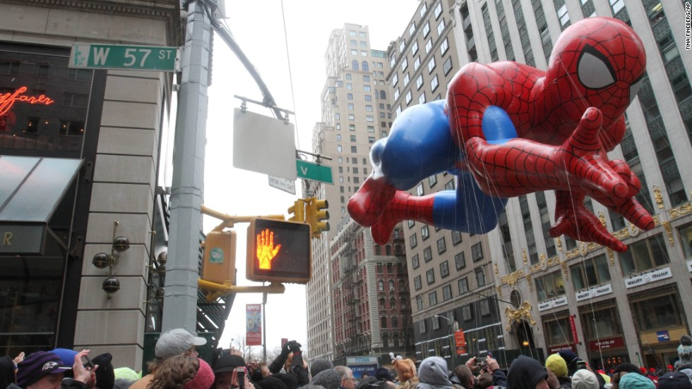 The Spider-Man balloon makes its way down New York's Sixth Avenue during the 88th annual Macy's Thanksgiving Day Parade on Thursday, November 27, 2014.