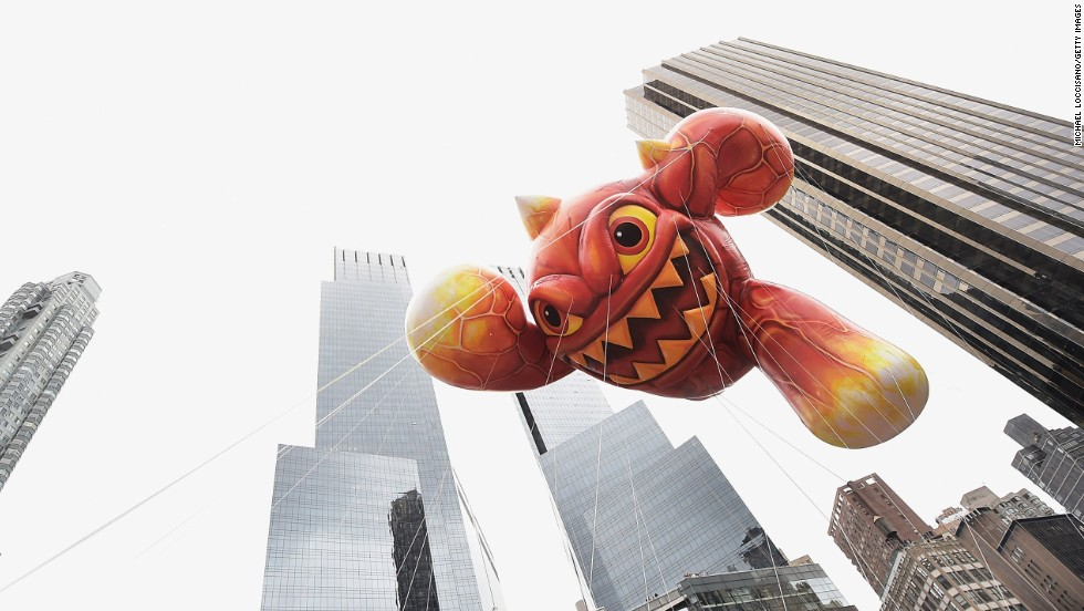 "Eruptor from the video game ""Skylanders"" floats through New York's skyline."