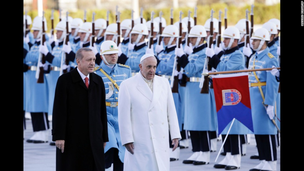 Turkish President Recep Tayyip Erdogan welcomes Pope Francis at the presidential palace in Ankara on November 28.