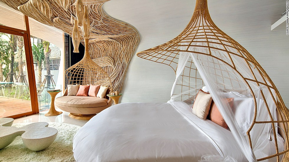 """Eclectic"" is an understatement at Iniala Beach House in Phang Nga, Thailand. Ten designers created the hotel's varied spaces, leading to cocoon-like canopy beds, gold leaf-covered dome in the spa room and a ""kids hotel"" wing with mini-bathrobes and slippers."