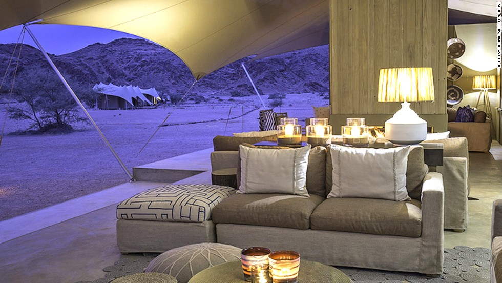 Accessible only by light aircraft, Hoanib Skeleton Coast Camp is a secluded tent resort in Namibia's mysterious Skeleton Coast. The 100% solar-powered camp features a swimming pool.