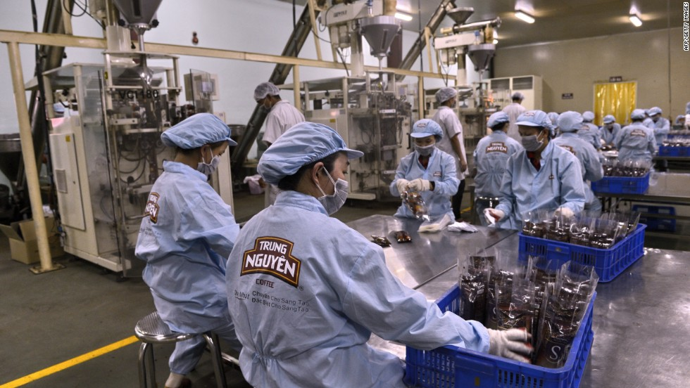 Workers pack coffee at a factory in Vietnam. Small and medium-sized companies in the South East Asian country are taking advantage of a boom created by a free trade agreement between China and Vietnam.