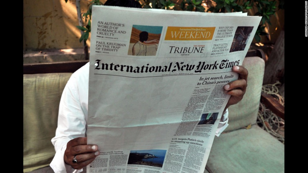 "<strong>March 24:</strong> A man reads a copy of the International New York Times at an office in Karachi, Pakistan. The New York Times said <a href=""http://www.nytimes.com/2014/03/23/business/media/times-report-on-al-qaeda-is-censored-in-pakistan.html"" target=""_blank"">an article about Pakistan's relationship to al Qaeda was censored</a> by its local distributor in the country, leaving a blank space on its weekend edition."