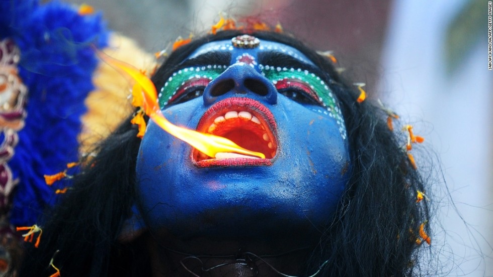 <strong>April 8: </strong>An artist dressed as the Hindu goddess Kali participates in a procession to celebrate the Ram Navami festival in Allahabad, India.