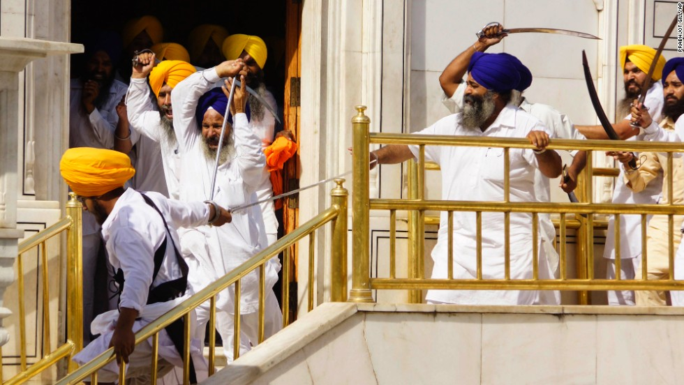 <strong>June 6:</strong> Members of a hardline Sikh group clash with guards of the Golden Temple, the religion's holiest shrine, in Amritsar, India. Half a dozen people were wounded, officials said.