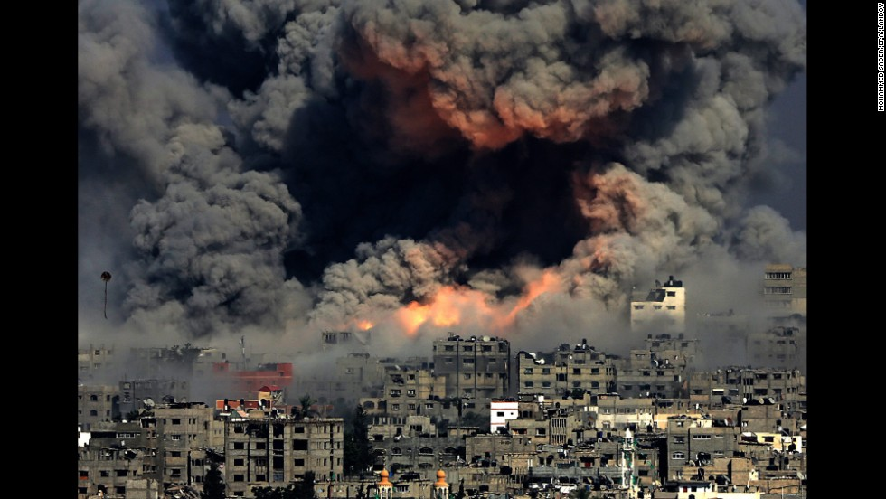 "<strong>July 29:</strong> Smoke rises in Gaza City after Israeli airstrikes. Israel <a href=""http://www.cnn.com/2014/07/18/world/gallery/israel-gaza/index.html"">launched a ground operation in Gaza</a> after a 10-day campaign of airstrikes failed to halt relentless Hamas rocket fire on Israeli cities. After more than seven weeks of heavy fighting, Israel and Hamas agreed to an open-ended ceasefire that put off dealing with core long-term issues."