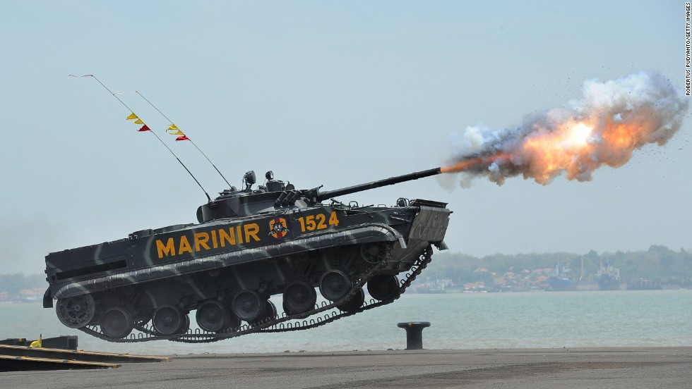 <strong>October 7:</strong> A tank from the Indonesian Marine Corps fires projectiles in Surabaya, Indonesia, for the military's 69th anniversary.