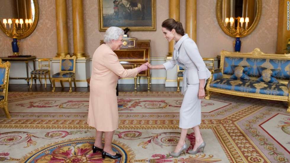 "<strong>October 10:</strong> Actress Angelina Jolie, right, is presented with an honorary damehood by Britain's Queen Elizabeth II at London's Buckingham Palace. <a href=""http://www.cnn.com/2014/10/10/showbiz/britain-angelina-jolie/"">Jolie was recognized</a> for her campaign to end sexual violence in war zones. <a href=""http://www.cnn.com/2013/05/14/showbiz/gallery/angelina-jolie/index.html"">See more photos of Jolie's life and career</a>"