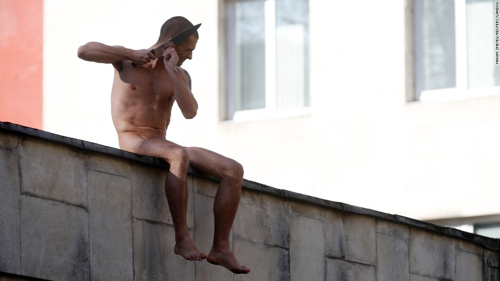 "<strong>October 19:</strong> Pyotr Pavlensky cuts off a part of his earlobe while sitting on a wall enclosing the Serbsky Center, a psychiatric hospital in Moscow. Pavlensky was protesting what he said was the use of forensic psychiatry for politically motivated purposes. He said he cut off part of his earlobe to demonstrate how authorities could ""cut off"" an unwanted individual from society."