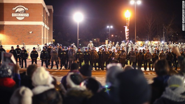 Police confront demonstrators outside the police station on November 28, in Ferguson, Missouri.