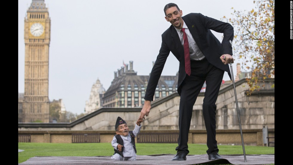 <strong>November 13:</strong> Chandra Bahadur Dangi, the shortest adult ever verified by Guinness World Records, poses with the world's tallest man, Sultan Kosen, in London. Dangi is 21 ½ inches tall, while Kosen is 8 feet, 3 inches tall.