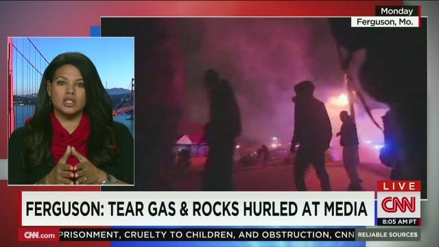 Ferguson.Media.face.tear.gas.rocks_00045010.jpg
