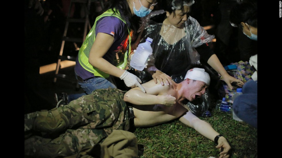 A protester reacts after being hit by pepper spray on November 30.