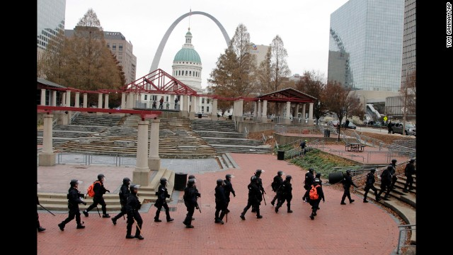 Officers wearing riot gear walk through a park in downtown St. Louis on November 30.