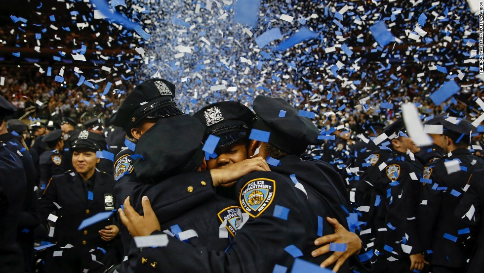 <strong>June 30:</strong> Members of the New York City Police Academy embrace during their graduation ceremony.