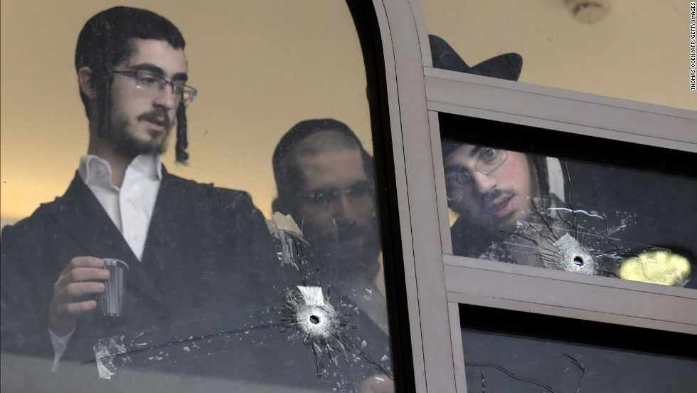 "<strong>November 18:</strong> Men look at bullet holes on the main window of a Jerusalem synagogue that was attacked by two Palestinian men. <a href=""http://www.cnn.com/2014/11/18/middleeast/gallery/jerusalem-synagogue-attack/index.html"">Four worshippers and a police officer were killed and several others were wounded</a> in the deadliest terror attack in Jerusalem since 2008."