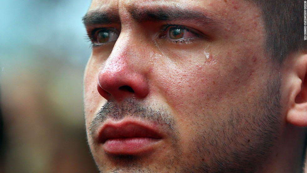 "<strong>April 15:</strong> Boston University student Sebastian Filgueira-Gomez has tears in his eyes during a moment of silence for the<a href=""http://www.cnn.com/2014/04/15/us/gallery/boston-bombing-memorial/index.html""> one-year anniversary of the Boston Marathon bombings</a>. He was standing on Boston's Boylston Street, a block from the marathon's finish line."