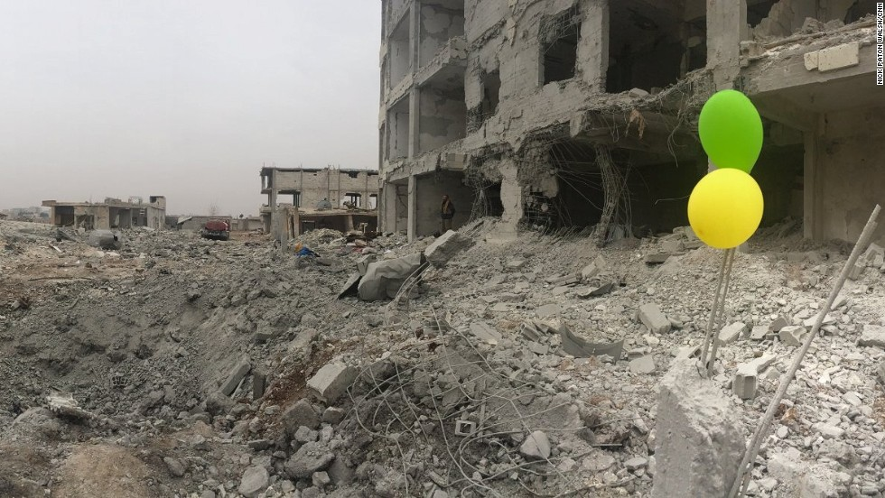 """Every time you open your eyes in Kobani, you see the damage,"" writes CNN's Nick Paton Walsh. ""There are people still there, but it is hard to gauge how many."""