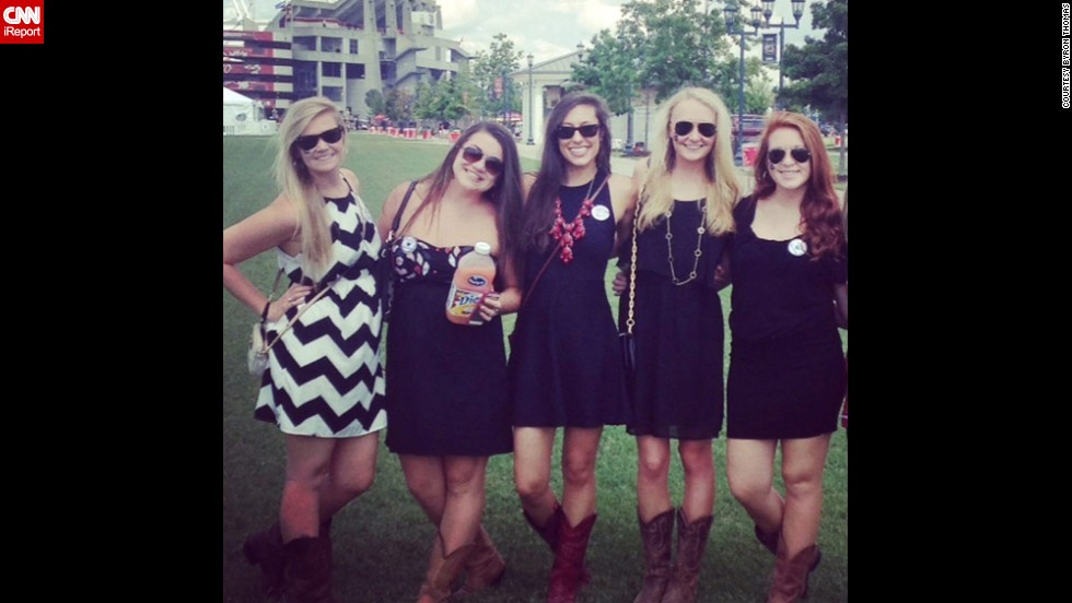 "At the University of South Carolina, Southern gentlemen ""allow our ladies to take the spotlight,"" says student <a href=""http://ireport.cnn.com/docs/DOC-1187880"">Byron Thomas</a>, who shot this photo of his friends. Girls typically wear garnet or black sundresses paired with ""cowgirl"" boots. ""You'll see a lot of girls walking home barefoot because the cowgirl boots hurt their feet from all the standing and jumping,"" Thomas said."