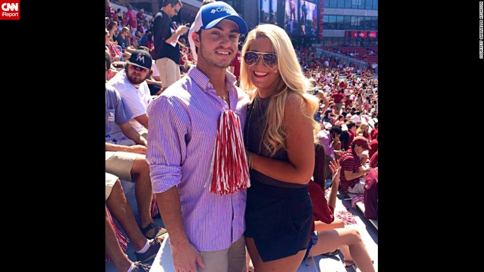"For guys, button-down shirts and khakis are game-day staples. University of Alabama sophomore <a href=""http://ireport.cnn.com/docs/DOC-1191656"">Gabrielle Atchison</a>, right, poses with a friend at the Bryant Denny Stadium in Tuscaloosa."