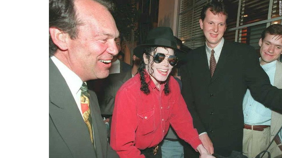 Pop superstar Michael Jackson plays Sony's then-new PlayStation in May 1995 as Sony Corp of America CEO Michael Schulhof, left, and Phil Harrison of Sony Computer Entertainment-Europe look on. This photo was taken at the Electronic Entertainment Expo in Los Angeles.