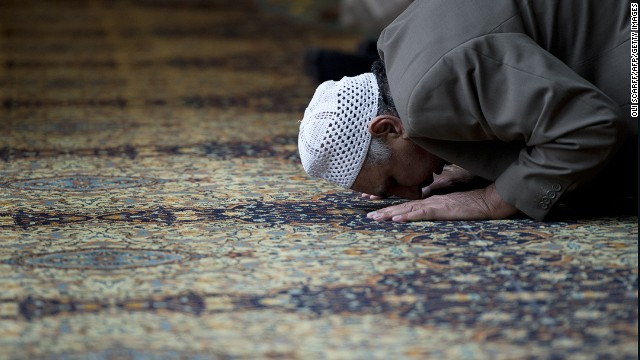 A Muslim man prays for murdered aid worker Alan Henning in Manchester Central Mosque, England on October 4, 2014.