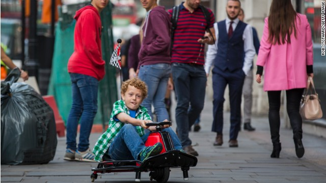 Caption:LONDON, ENGLAND - JUNE 26: Archie, aged 8, drives a 'Razor Crazy Cart' outside the Hamley's toy shop on June 26, 2014 in London, England. The go-kart, which retails for 625 GBP, is included in Hamleys' predictions for the top selling toys for Christmas 2014. (Photo by Rob Stothard/Getty Images)