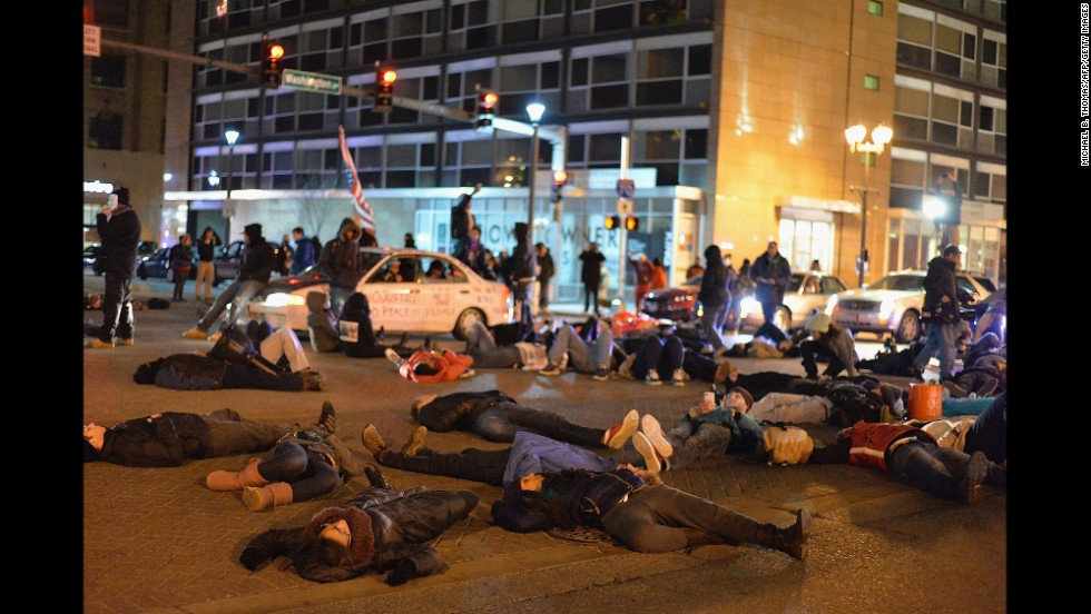Demonstrators lie in the streets of St. Louis on December 3.
