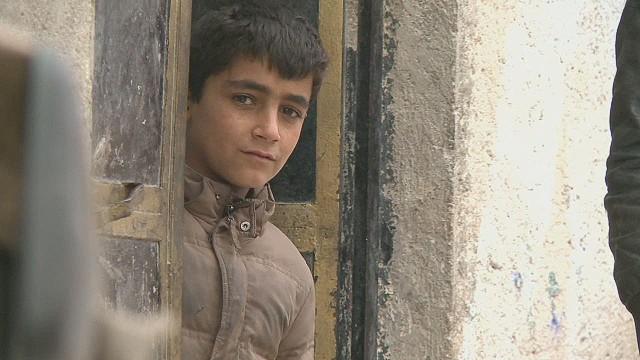 pkg paton walsh syria kobani survivors_00005410.jpg