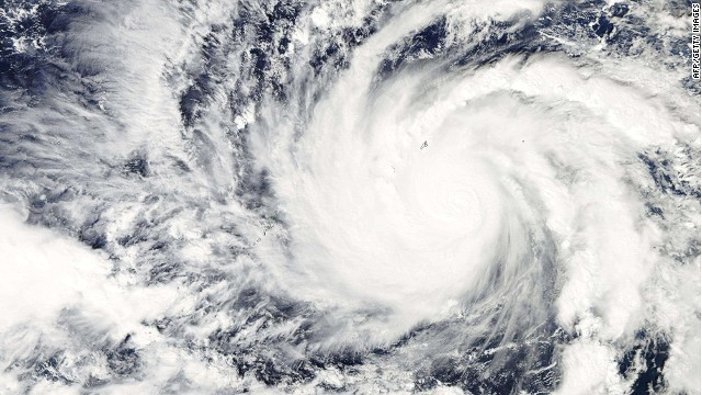 "This December 3, 2014 NASA satellite image shows Typhoon Hagupit in the Western Pacific Ocean. Typhoon Hagupit was building strength in the Pacific Ocean December 3 as it moved towards central Philippine islands where impoverished farming and fishing communities are yet to recover from the previous devastation. Hundreds of Tacloban residents are still sheltered in flimsy tents as Typhoon Hagupit headed west for the central islands of Samar and Leyte, and would make landfall as early as December 6 afternoon with gusts of up to 170 kilometres (106 miles) an hour, the state weather station said. AFP PHOTO / Handout / NASA == RESTRICTED TO EDITORIAL USE / MANDATORY CREDIT: ""AFP PHOTO / HANDOUT / NASA ""/ NO MARKETING / NO ADVERTISING CAMPAIGNS / NO A LA CARTE SALES / DISTRIBUTED AS A SERVICE TO CLIENTS ==Handout/AFP/Getty Images"