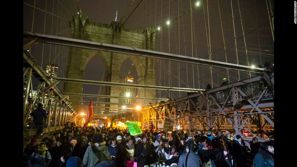 Demonstrators march across the Brooklyn Bridge on December 4.