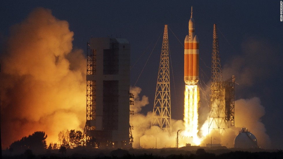 NASA's Orion spacecraft, atop a Delta 4-Heavy rocket, lifts off on its first unmanned orbital test flight from Cape Canaveral, Florida, on Friday, December 5. NASA hopes Orion will usher in a new era: eventual human exploration of deep space.