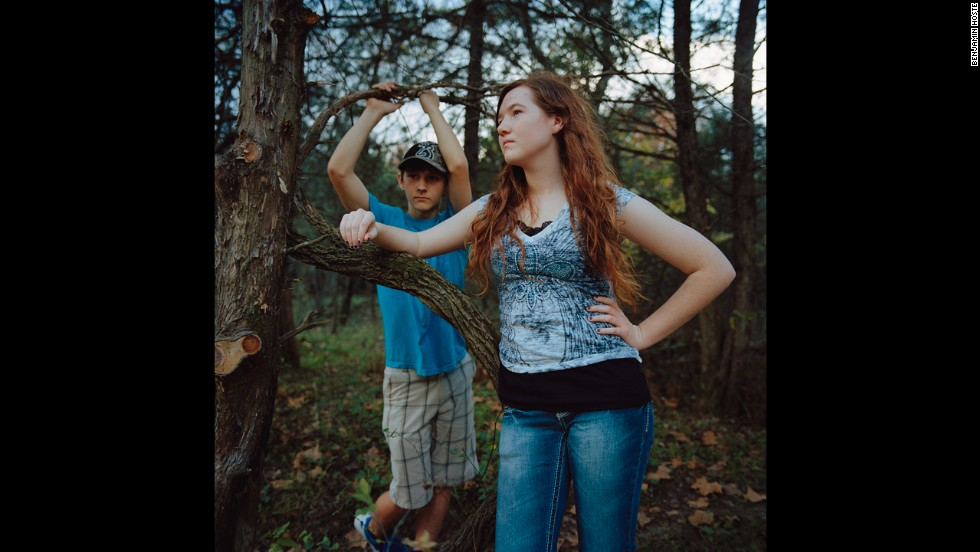 Shalyn Steinbrink and Dylan Daeis in the woods on Hartzog Farm.